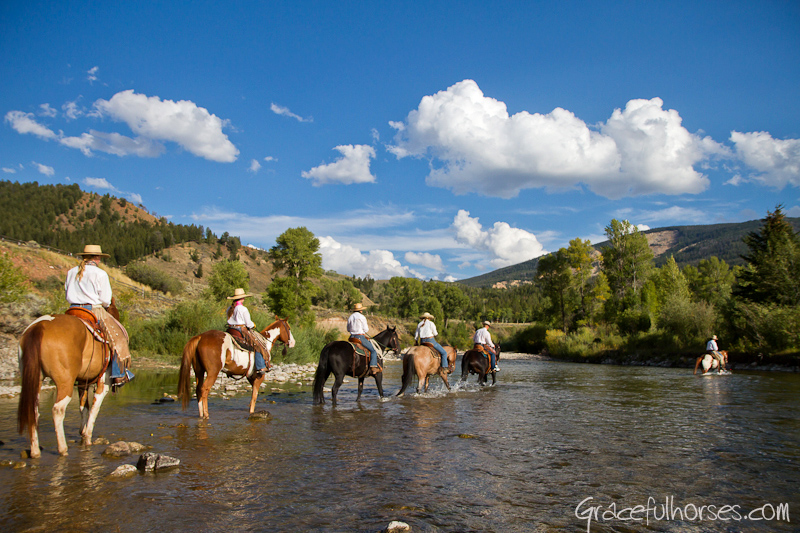 Wranglers crossing the Gros Ventr River